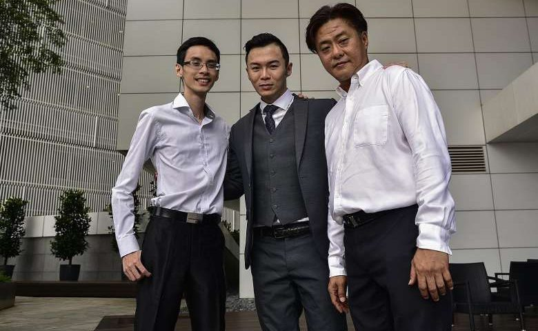 Mr Francis Leo (far right) with his bosses at Pinnacle One Consultancy - CEO Jack Ser (centre) and chief operating officer Kenneth Tan - who are impressed at how much he has learnt through the PCP.ST PHOTO: DESMOND WEE